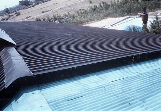 Perforated solar panels mounted on the roof.
